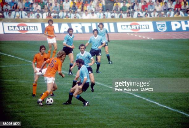 Holland's Johnny Rep takes on Uruguay's Ricardo Pavoni watched by teammates Johan Cruyff and Rob Rensenbrink and Uruguay's Pablo Forlan Julio Montero...
