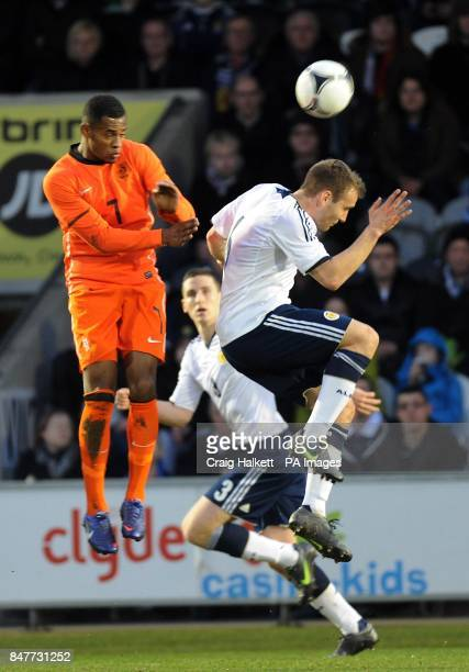 Holland's Leandro Bacuna and with Scotland's Liam Kelly battle for the ball during the 2013 Euro Under 21 Championship Qualifying match at St Mirren...