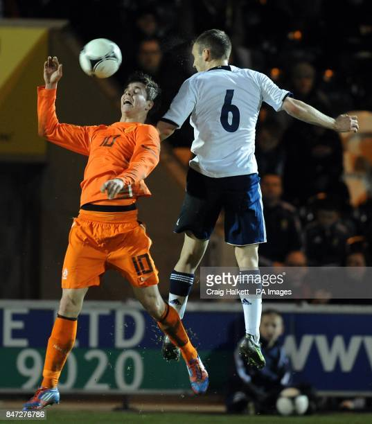 Holland's Marco Vanginkel and Scotland's Liam Kelly challenge for ball in the air during the 2013 Euro Under 21 Championship Qualifying match at St...