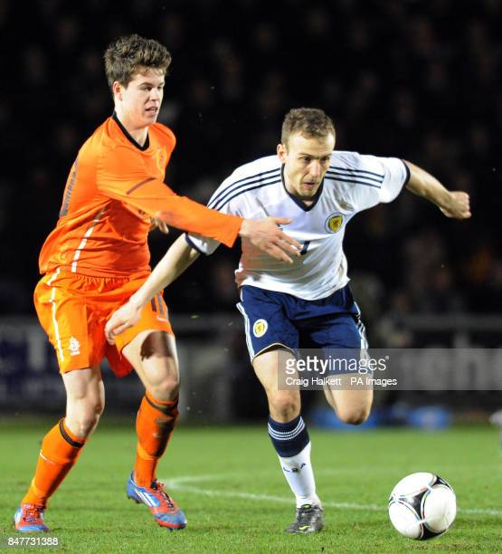 Holland's Marco Vanginkel challenges Scotland's Liam Kelly during the 2013 Euro Under 21 Championship Qualifying match at St Mirren Park Paisley