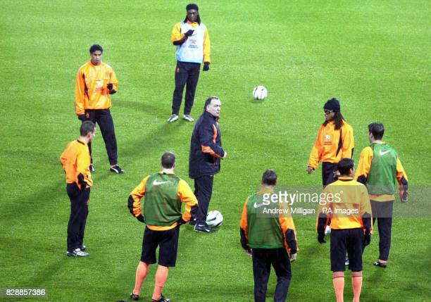 Hollands national soccer squad manager Dick Advocaat with team members training at Hampden Park Glasgow preparing for their Euro 2004 playoff match...