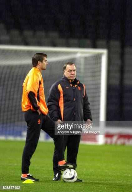 Hollands national soccer squad manager Dick Advocaat with team member Philip Cocu during training at Hampden Park Glasgow preparing for their Euro...
