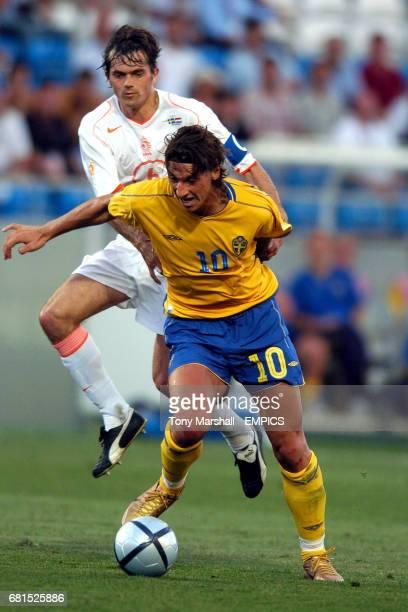 Holland's Phillip Cocu pulls back Sweden's Zlatan Ibrahimovic