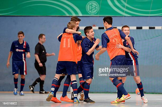 Hollenbach players celebrate after reaching the DFB C Juniors Futsal Cup final on March 24 2013 in Bergkamen Germany