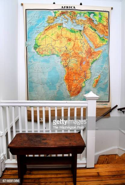 Holley Simmons say to use large pieces of unframed art such as a map versus many small ones as she has a map of Africa on the stairway wall April 17...