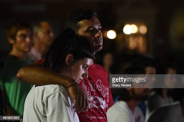 Holli Tatum and her boyfriend Robert Vied participate in a candlelight vigil held on the cmpus of Louisiana Lafayette on July 24 2015 in Lafayette...