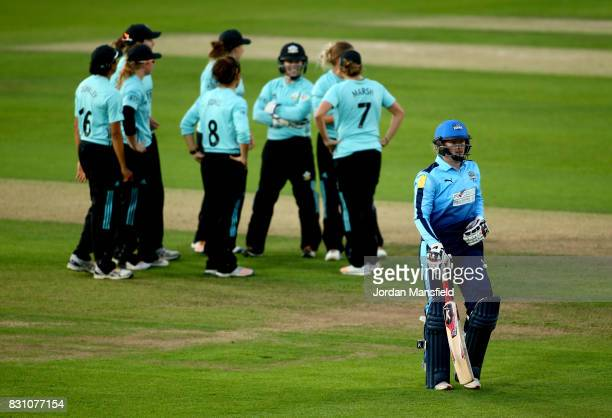 Hollie Armitage of Yorkshire walks off the field after being dismissed by Alex Hartley of Surrey during the Kia Super League match between Surrey...