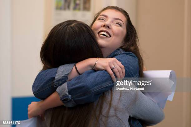 Hollie Jones hugs a friend after receiving her GCSE results at Ffynone House School on August 24 2017 in Swansea Wales Welsh pupils will still be...