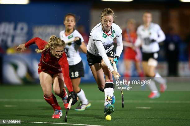Hollie Webb of England battles with Franziska Hauke of Germany during day 4 of the FIH Hockey World League Women's Semi Finals Pool A match between...