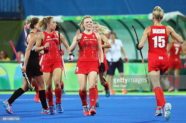 Hollie Webb of Great Britain Alex Danson of Great Britain and Susannah Townsend of Great Britain celebrate scoring during the Women's Semifinal match...