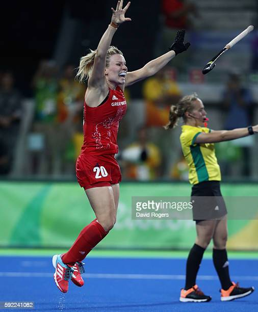 Hollie Webb of Great Britain celebrates after scoring the winning penalty against the Netherlands during the Women's hockey Gold medal match between...