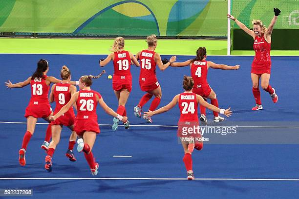Hollie Webb of Great Britain celebrates with teammates after scoring the gamewinning penalty goal against the Netherlands during the Women's Gold...