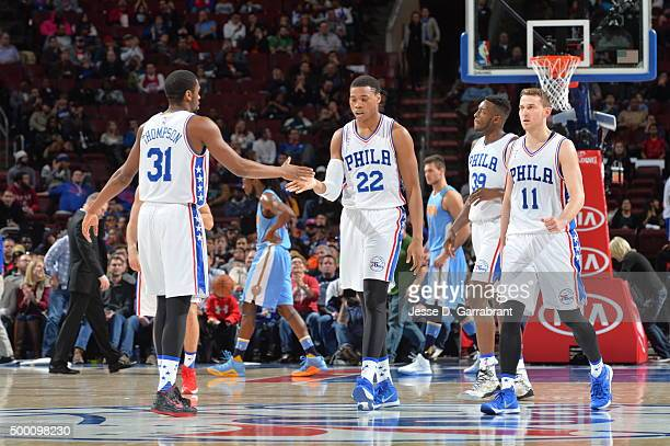 Hollis Thompson and Richaun Holmes of the Philadelphia 76ers shake hands against the Denver Nuggets at Wells Fargo Center on December 5 2015 in...