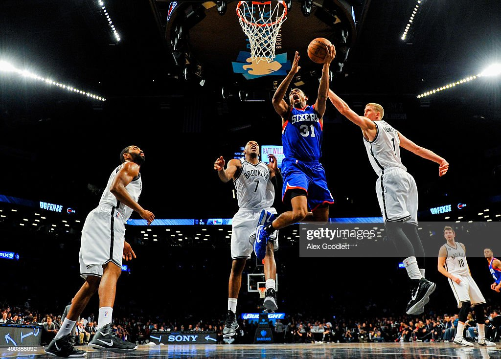 <a gi-track='captionPersonalityLinkClicked' href=/galleries/search?phrase=Hollis+Thompson&family=editorial&specificpeople=6586021 ng-click='$event.stopPropagation()'>Hollis Thompson</a> #31 of the Philadelphia 76ers attempts a shot over <a gi-track='captionPersonalityLinkClicked' href=/galleries/search?phrase=Mason+Plumlee&family=editorial&specificpeople=5792012 ng-click='$event.stopPropagation()'>Mason Plumlee</a> #1 and <a gi-track='captionPersonalityLinkClicked' href=/galleries/search?phrase=Joe+Johnson+-+Basketball+Player&family=editorial&specificpeople=201652 ng-click='$event.stopPropagation()'>Joe Johnson</a> #7 of the Brooklyn Nets in the second half at the Barclays Center on December 12, 2014 in the Brooklyn borough of New York City.
