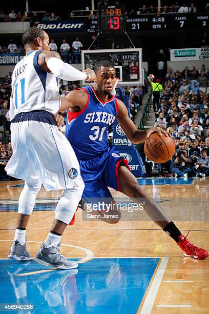 Hollis Thompson of the Philadelphia 76ers drives against the Dallas Mavericks on November 13 2014 at the American Airlines Center in Dallas Texas...