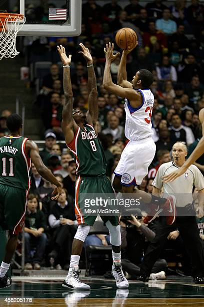 Hollis Thompson of the Philadelphia 76ers drives to the hoop for two points against Larry Sanders of the Milwaukee Bucks during the second half at...