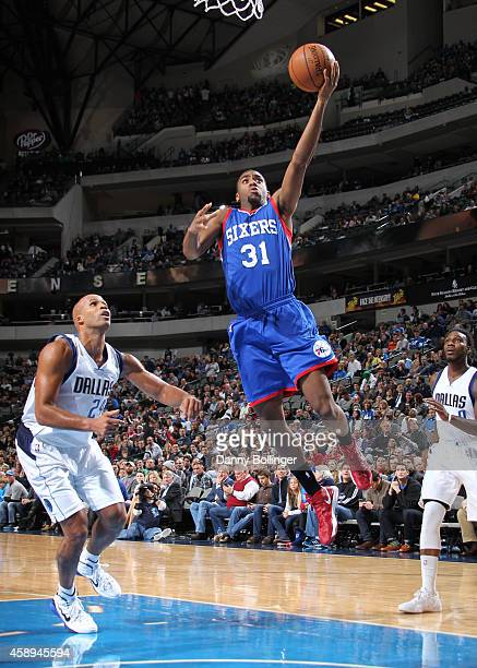 Hollis Thompson of the Philadelphia 76ers goes in for the layup against the Dallas Mavericks on November 13 2014 at the American Airlines Center in...