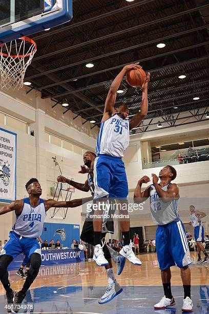 Hollis Thompson of the Philadelphia 76ers grabs a rebound against the Orlando Magic during the Samsung NBA Summer League 2014 on July 5 2014 at Amway...