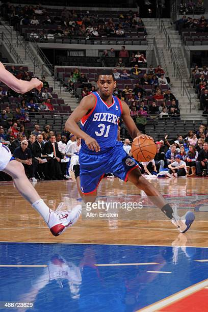 Hollis Thompson of the Philadelphia 76ers handles the ball against the Detroit Pistons on February 1 2014 at The Palace of Auburn Hills in Auburn...