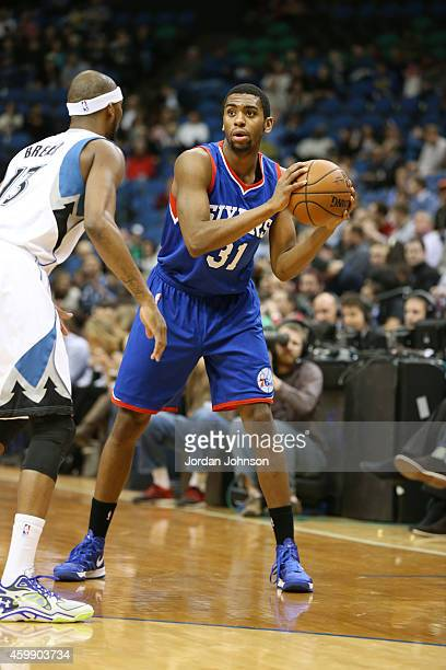 Hollis Thompson of the Philadelphia 76ers looks to move the ball against the Minnesota Timberwolves during the game on December 3 2014 at Target...