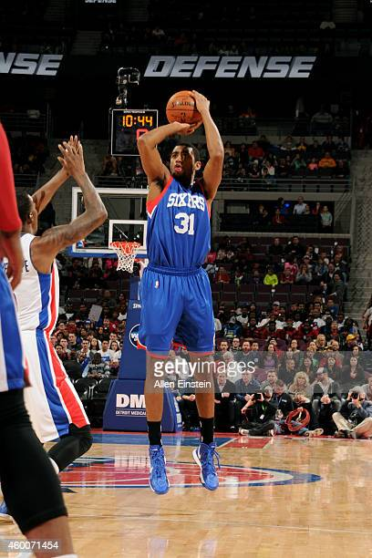 Hollis Thompson of the Philadelphia 76ers shoots against the Detroit Pistons on December 6 2014 at The Palace of Auburn Hills in Auburn Hills...