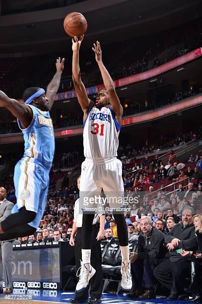 Hollis Thompson of the Philadelphia 76ers shoots the ball against the Denver Nuggets at Wells Fargo Center on February 3 2015 in Philadelphia...