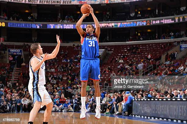 Hollis Thompson of the Philadelphia 76ers shoots the ball against the Memphis Grizzlies at the Wells Fargo Center on March 15 2014 in Philadelphia...