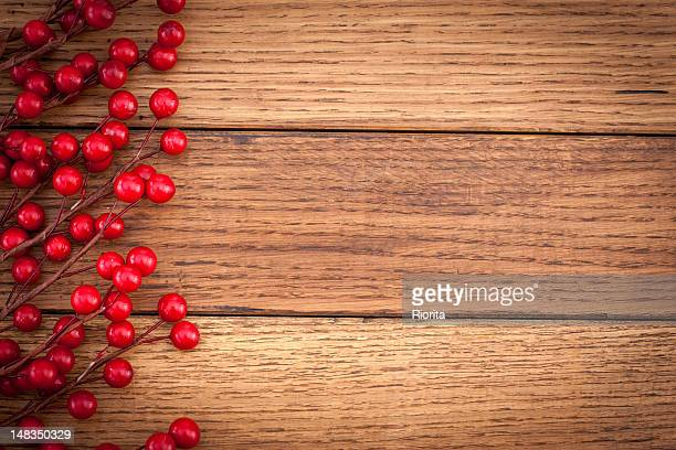 Holly berry on wooden background
