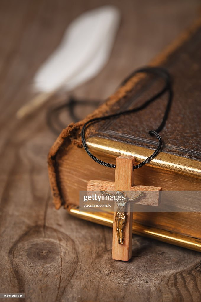 holly Bible and cross : Stock Photo