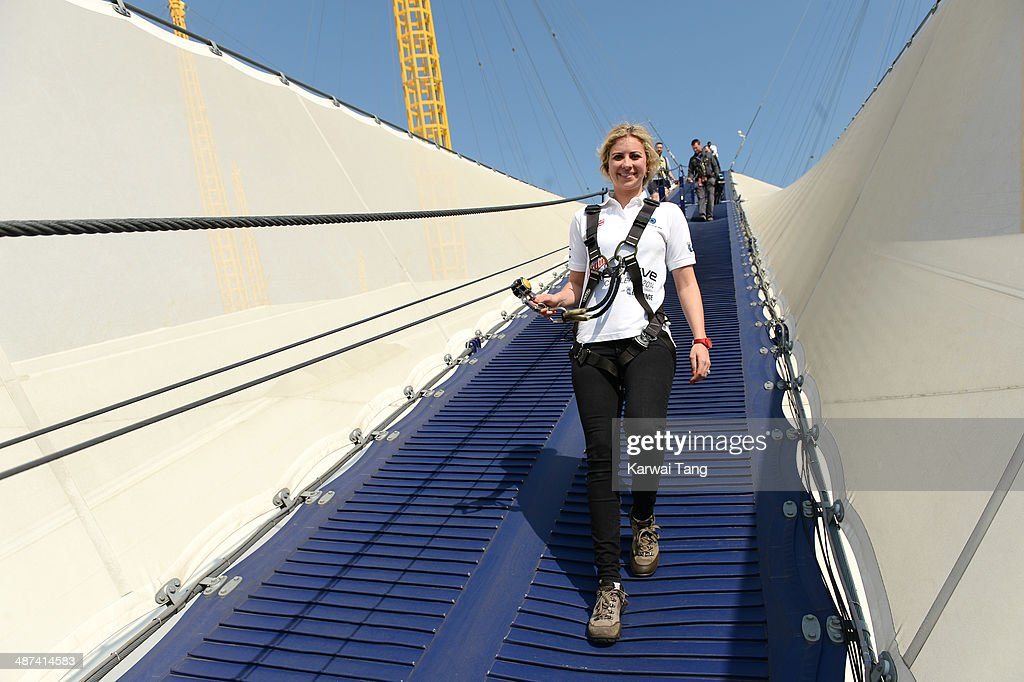 Holly Branson scales the 02 Arena during a photocall to launch the Virgin STRIVE Challenge held at the 02 Arena on April 30, 2014 in London, England.