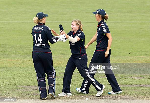Holly Colvin of England celebrates a wicket during the fifth Twenty20 match between Australia and England at Manuka Oval on January 18 2011 in...