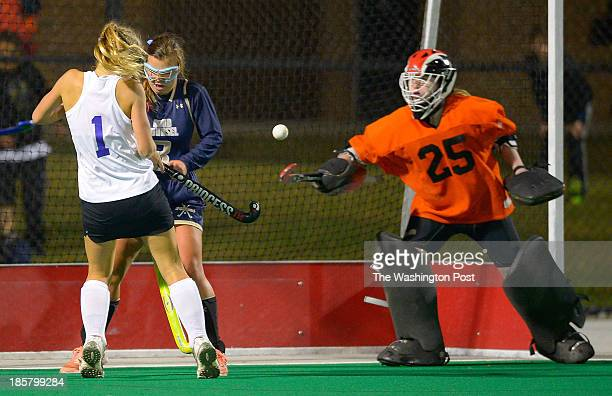 Holly Cross' Kate Taylor left and Good Councel's Lyndsey Gerold center compete for a loose ball in front of Good Councel's goalie Caroline Cambell...