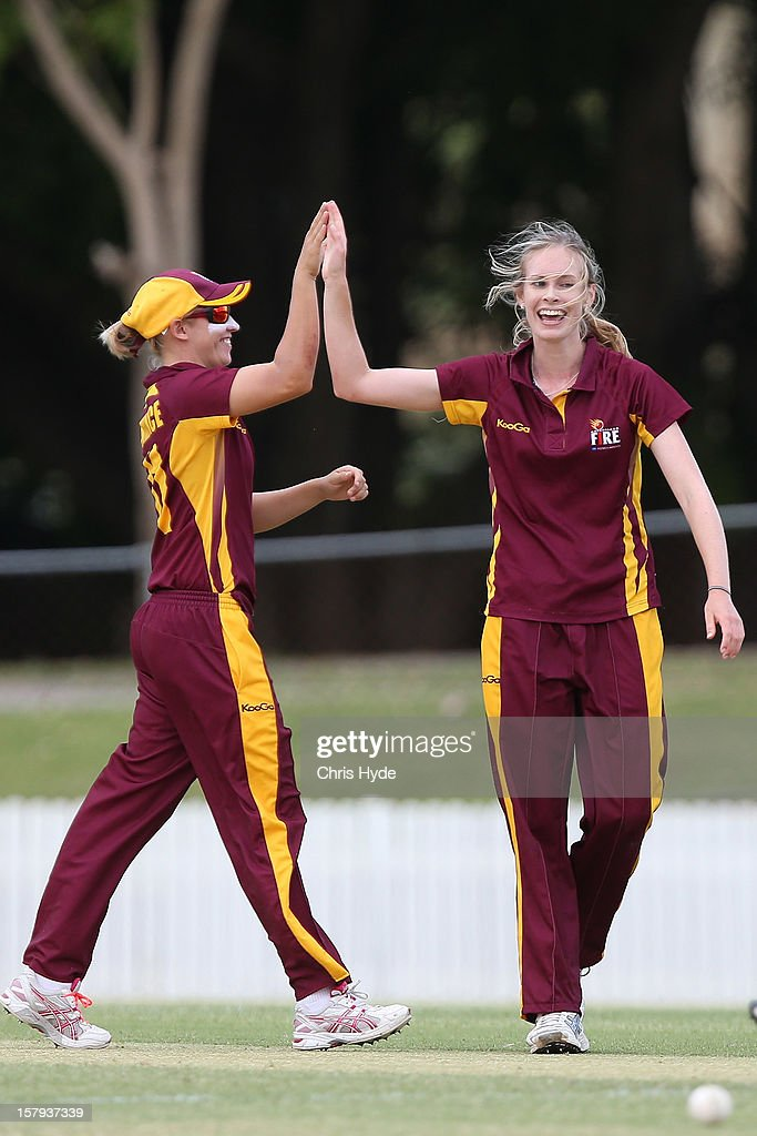Holly Ferling of the Fire celebrates a wicket during the WNCL match between the Queensland Fire and the Victoria Spirit at Allan Border Field on...