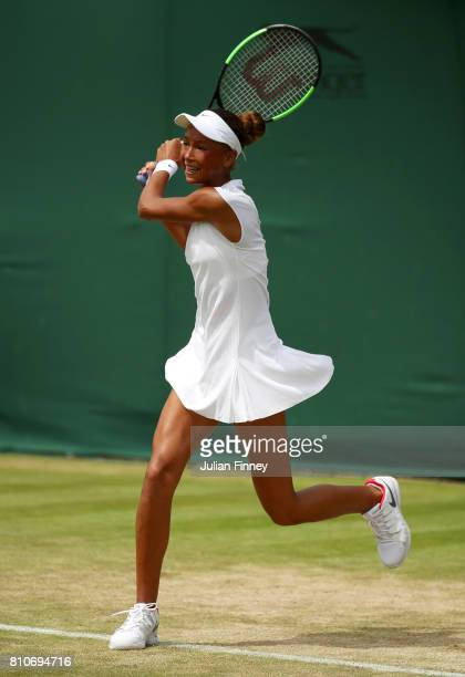 Holly Fischer of Great Britain plays a backhand during the Girl's Singles first round match against Mai Hontama of Japan on day six of the Wimbledon...