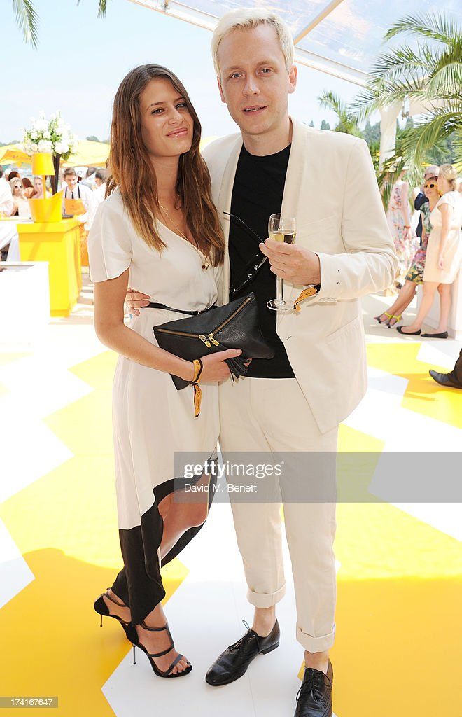 Holly Grace (L) and Mr Hudson attend the Veuve Clicquot Gold Cup Final at Cowdray Park Polo Club on July 21, 2013 in Midhurst, England.
