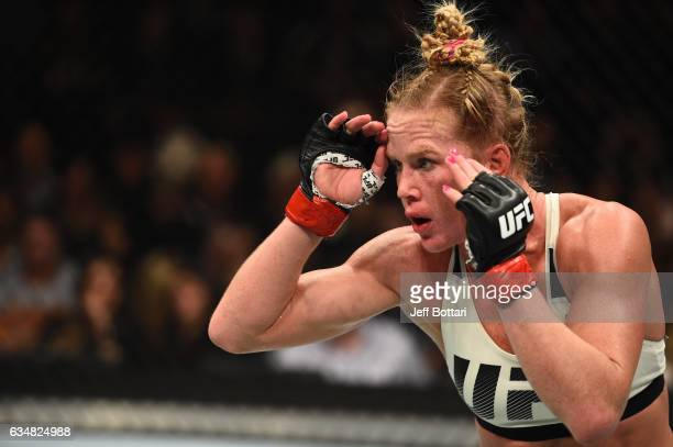 Holly Holm circles Germaine de Randamie of The Netherlands in their women's featherweight championship bout during the UFC 208 event inside Barclays...