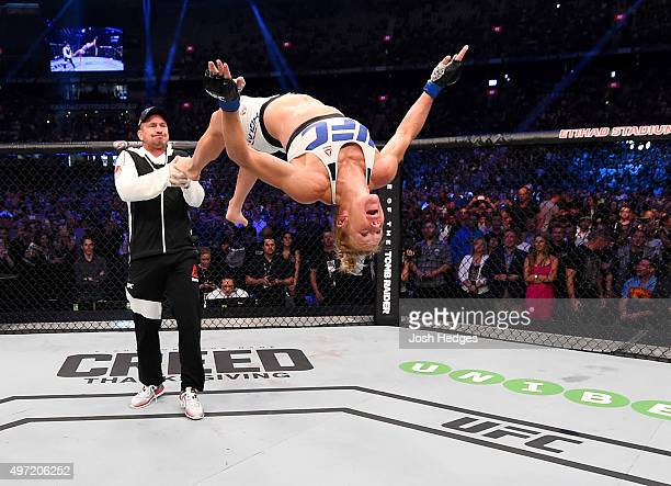 Holly Holm does a backflip in celebrateion of her second round KO over Ronda Rousey to win their UFC women's bantamweight championship bout during...