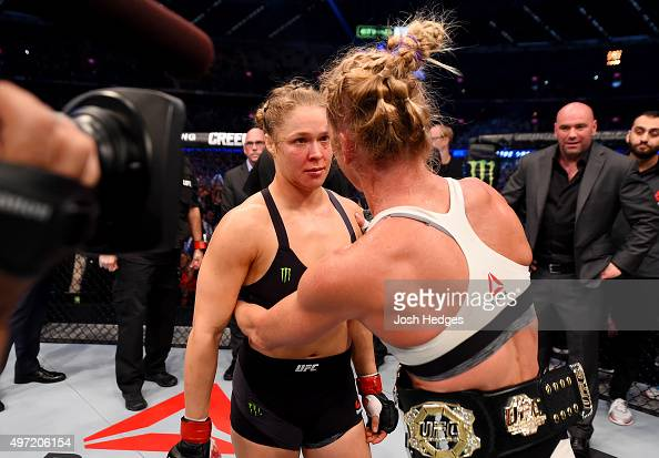 Holly Holm is congratulated by Ronda Rousey after Holm won by KO in two rounds of their UFC women's bantamweight championship bout during the UFC 193...