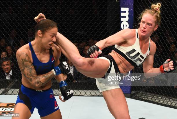 Holly Holm kicks Germaine de Randamie of The Netherlands in their women's featherweight championship bout during the UFC 208 event inside Barclays...