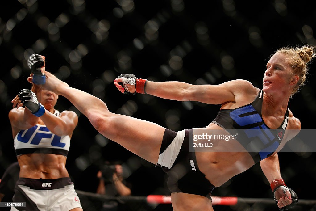 Holly Holm kicks Marion Reneau in their women's bantamweight bout during the UFC event at the Valley View Casino Center on July 15, 2015 in San Diego, California.