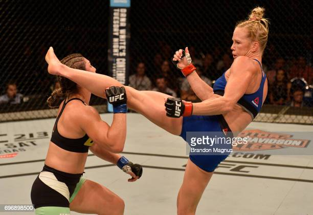 Holly Holm knocks out Bethe Correia of Brazil with a kick in their women's bantamweight bout during the UFC Fight Night event at the Singapore Indoor...