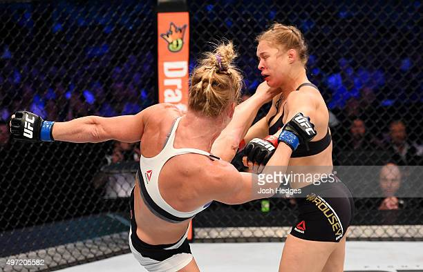 Holly Holm lands a lefthigh kick against Ronda Rousey in the second round of their UFC women's bantamweight championship bout during the UFC 193...