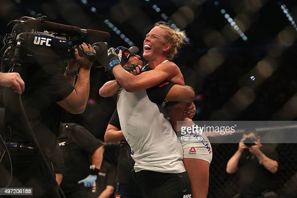 Holly Holm of the United States celebrates victory over Ronda Rousey of the United States in their UFC women's bantamweight championship bout during...