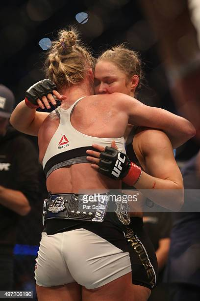 Holly Holm of the United States embraces Ronda Rousey of the United States following their UFC women's bantamweight championship bout during the UFC...