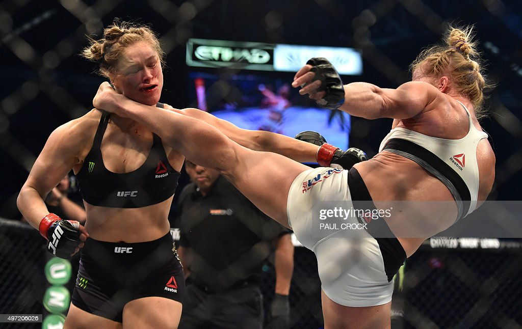Holly Holm of the US lands a kick to the neck to knock out compatriot Ronda Rousey and win the UFC title fight in Melbourne on November 15 2015...