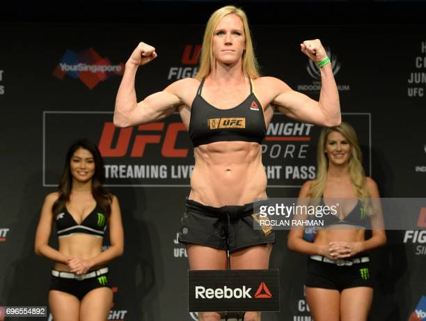 Holly Holm of the US stands on the weighing scale during the UFC Fight Night official weighin in Singapore on June 16 2017 Holly Holm of the US will...