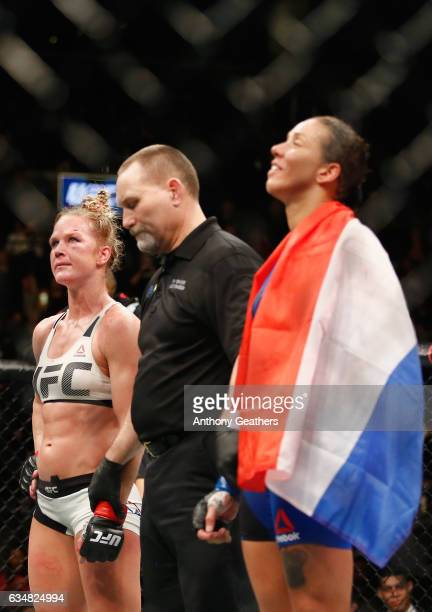Holly Holm of United States and Germaine de Randamie of The Netherlands wait to hear the decision after their UFC women's featherweight championship...