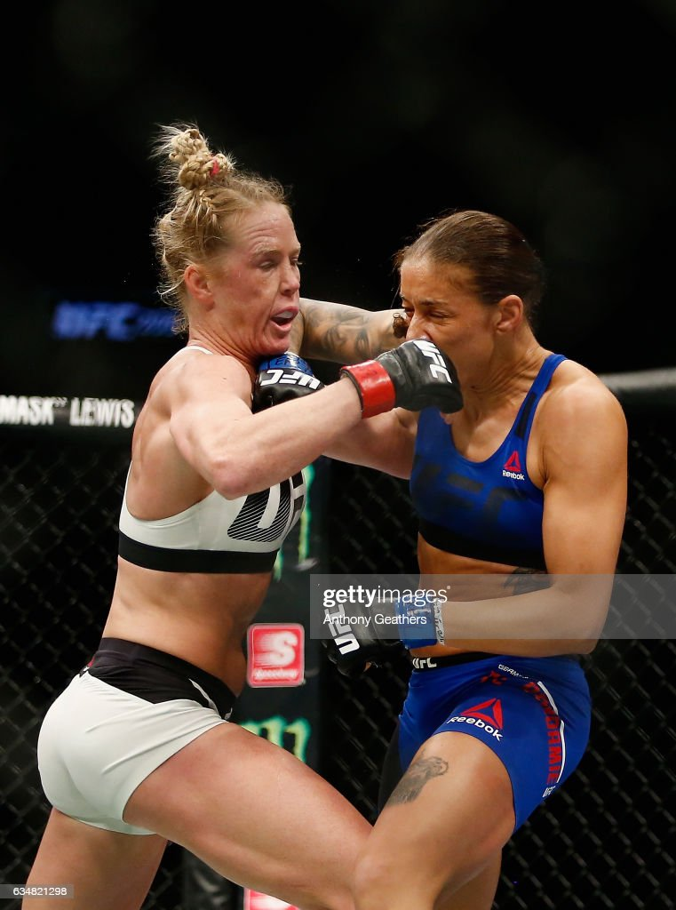 Holly Holm of United States exchanges punches with Germaine de Randamie of The Netherlands in their UFC women's featherweight championship bout during UFC 208 at the Barclays Center on February 11, 2017 in the Brooklyn Borough of New York City.
