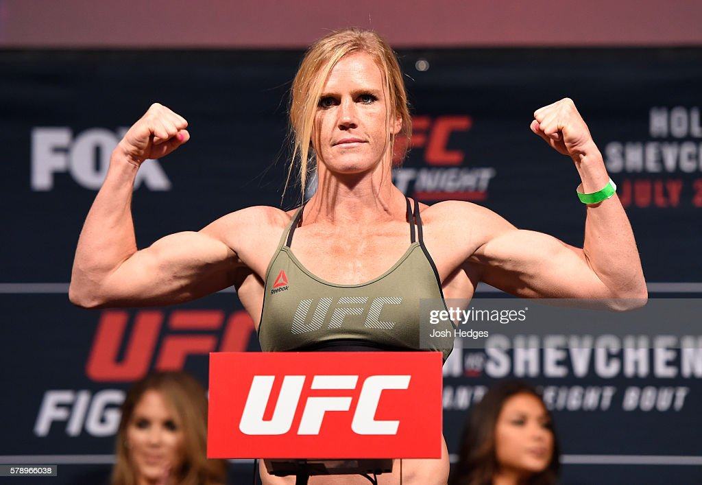 Holly Holm poses on the scale during the UFC weigh-in at the United Center on July 22, 2016 in Chicago, Illinois.