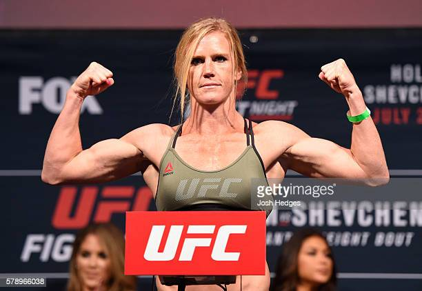 Holly Holm poses on the scale during the UFC weighin at the United Center on July 22 2016 in Chicago Illinois